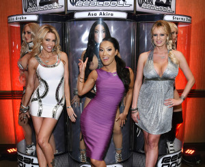 LAS VEGAS, NV - JANUARY 22: (EDITORS NOTE: Image contains partial nudity.) (L-R) Adult film actresses/directors jessica drake, Asa Akira and Stormy Daniels pose with their Wicked RealDolls at the 2015 AVN Adult Entertainment Expo at the Hard Rock Hotel & Casino on January 22, 2015 in Las Vegas, Nevada. (Photo by Ethan Miller/Getty Images)